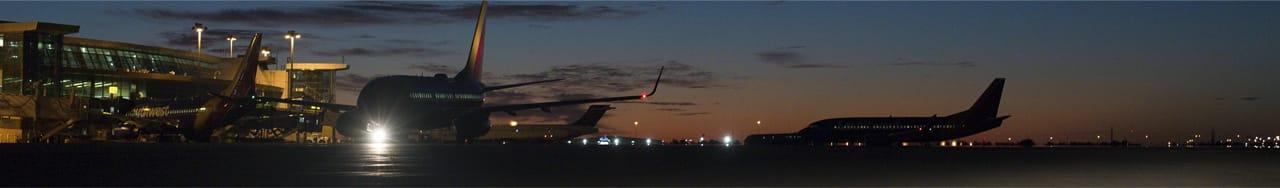 Image of Airplane tail at sunset - pilot information
