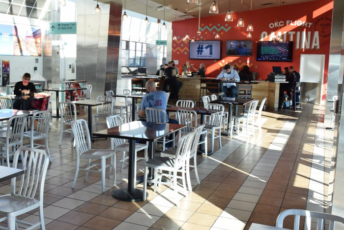 View of bar and eating space, looking out into the west concourse between gates 8 and 10