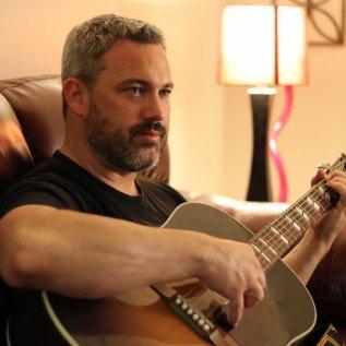 Aaron Newman playing guitar