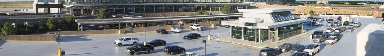 Aerial view of Hourly Parking, garage rooftop. Terminal building in the background.
